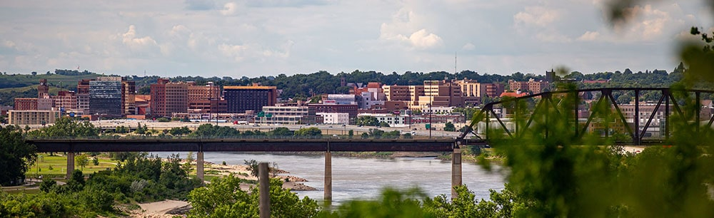 View of downtown Sioux City with the Missouri River and bridge in foreground.